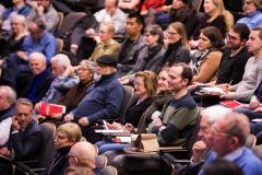 Image of lecture attendees in their seats